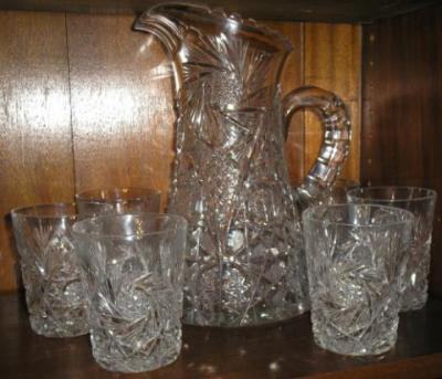American cut glass pitcher set. A few glasses have minor imperfections, pitcher is perfect